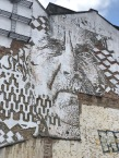 Street Art at the LX Factory- instead of paint though, try chipping into the plaster! Incredible!