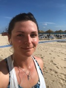 Happy and sweaty post run along the beach