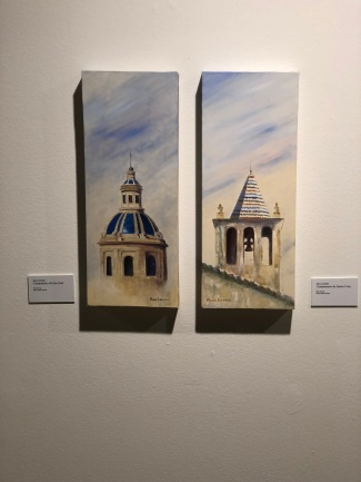 The art exhibition by Rosa Quintero; showing towers of the city