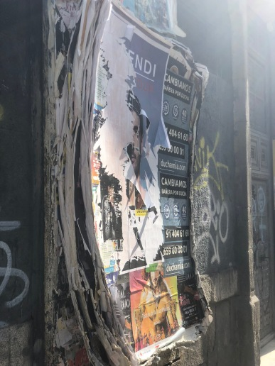 Posters in Madrid, I wonder how many layers they will keep adding until it all comes crashing down.